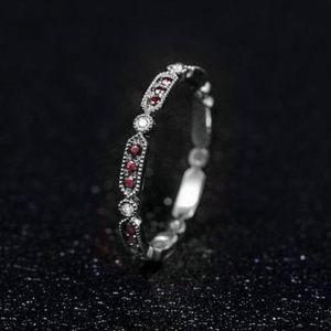 White gold, ruby, diamond eternity band